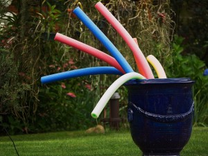 pool noodles in an urn