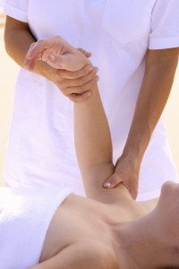 Woman receiving arm massage