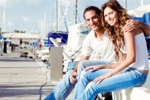 couple sitting on boat dock