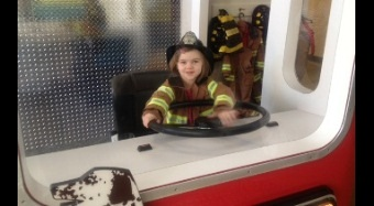 picture of a little girl in a fire engine