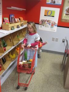 Girl in princess dress at play supermarket