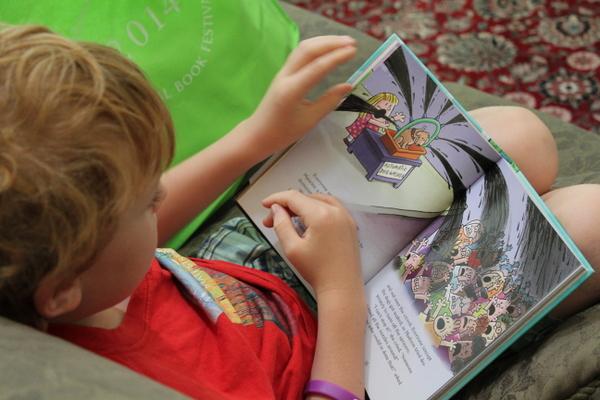 child reading Dav Pilkey from National Book Festival
